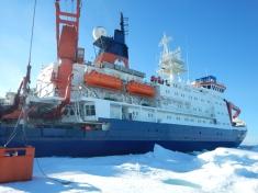 Polarstern alongside an ice floe